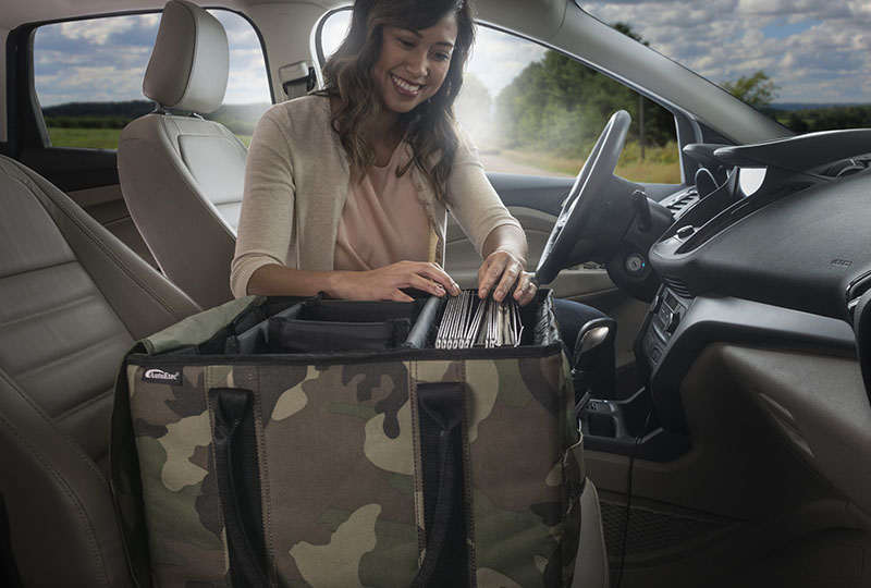 Woman working with car organizer